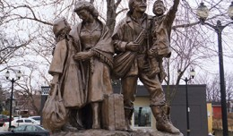 9_immigration_square_statue